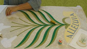 Working on applique church banner with lillies